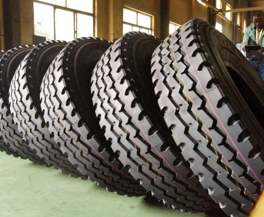 A row of commercial trailer tires in an auto shop